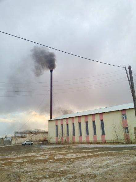 School gym in shadow of heat waste smoke