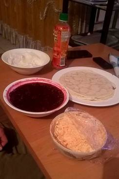 Túró (white filling in the back), palacsinta, blackberry and lingonberry mix, and körözött (orange spread)