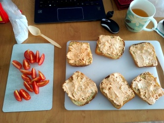 Toasted bread topped with körözött sided with tomatoes