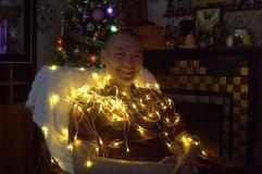 Byamba posing with Christmas lights