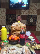 My host father hidden behind the enormous pastry/candy tower