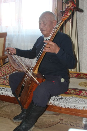 Playing his morin khuur