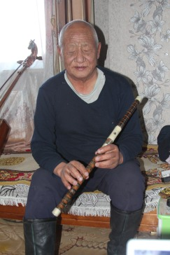 Preparing to play the 100 year old flute from China
