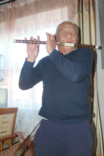 Playing his flute